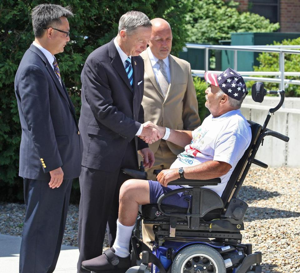 US Representative Stephen F. Lynch (flanked by VA health director Vincent Ng and Mayor Bill Carpenter) greeted Vietnam veteran Brian Ahearn, 64, in Brockton  on Friday.